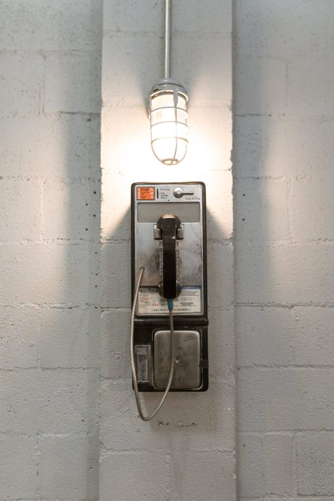 Picture of a payphone in a prison.