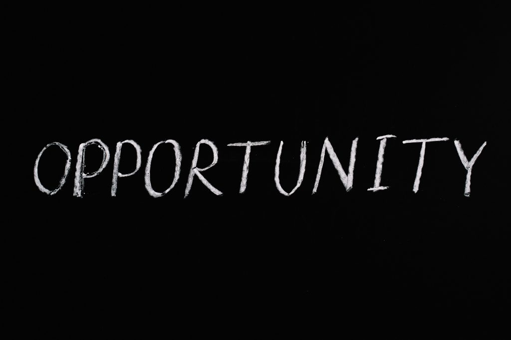 Image Description: The word opportunity written in white on a black background.