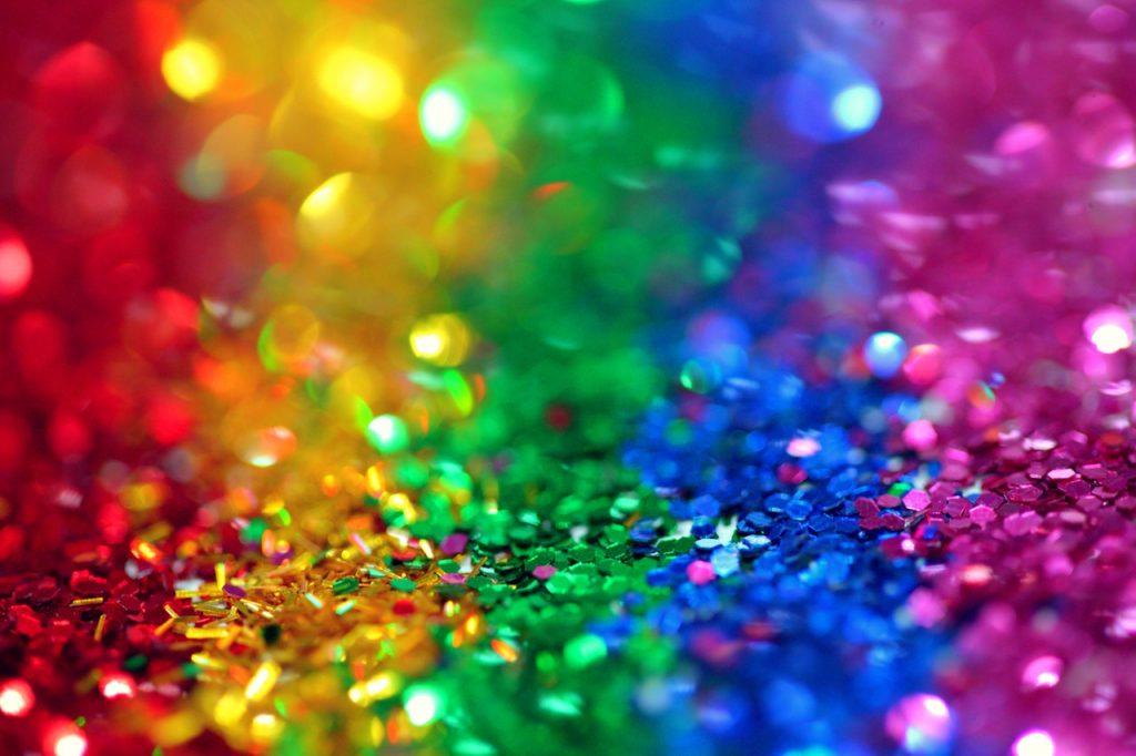 Image Description: A background of rainbow colored glitter.